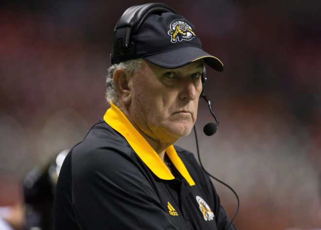 Hamilton Tiger-Cats' head coach June Jones stands on the sideline before a CFL football game against the B.C. Lions in Vancouver, B.C., on Friday September 22, 2017. THE CANADIAN PRESS/Darryl Dyck